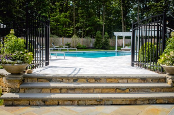 Pool stair stonework and fencing