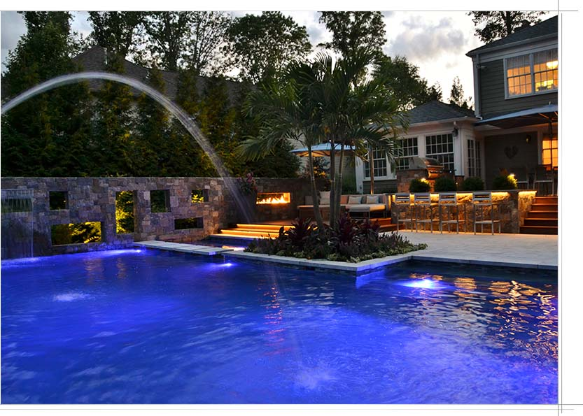 Custom pool with in-pool lighting features and water features
