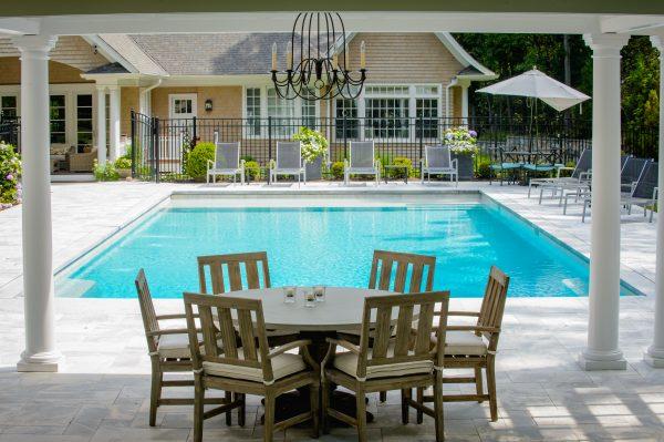 Custom pool design with pergola and columns