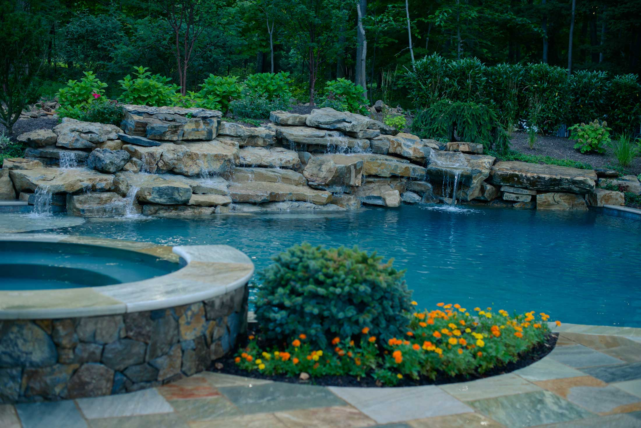 Custom Inground Pools with natural waterfall and hottub