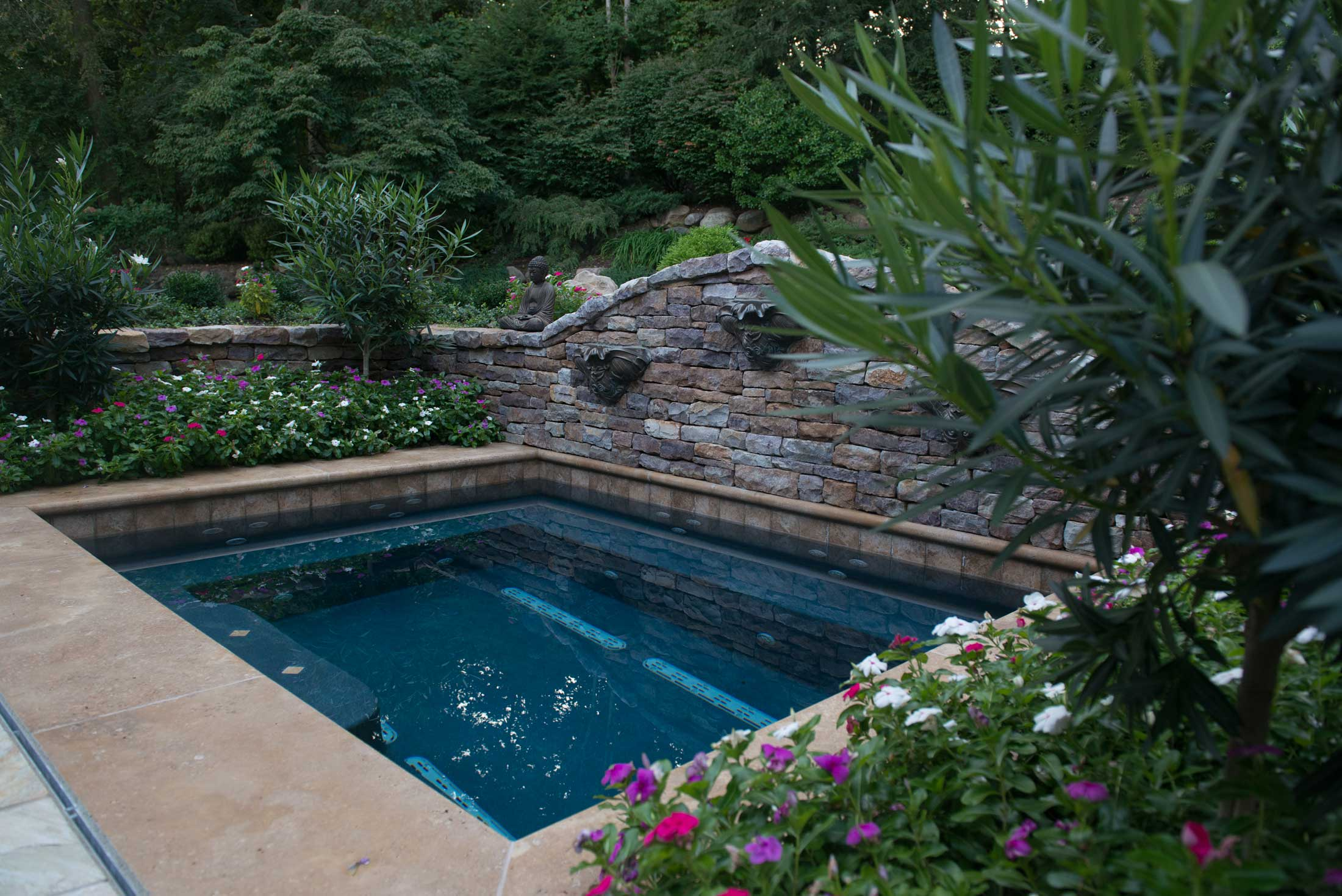 Custom Spa Design & Construction with flower beds and water features