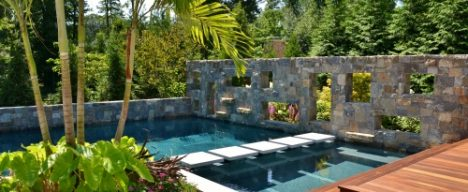 Custom pool design with stonework and patio