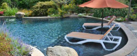 inground pool with lounge seating