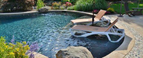 Lounge chairs in custom pool