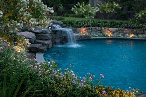 Custom pool with waterfall and ground lighting
