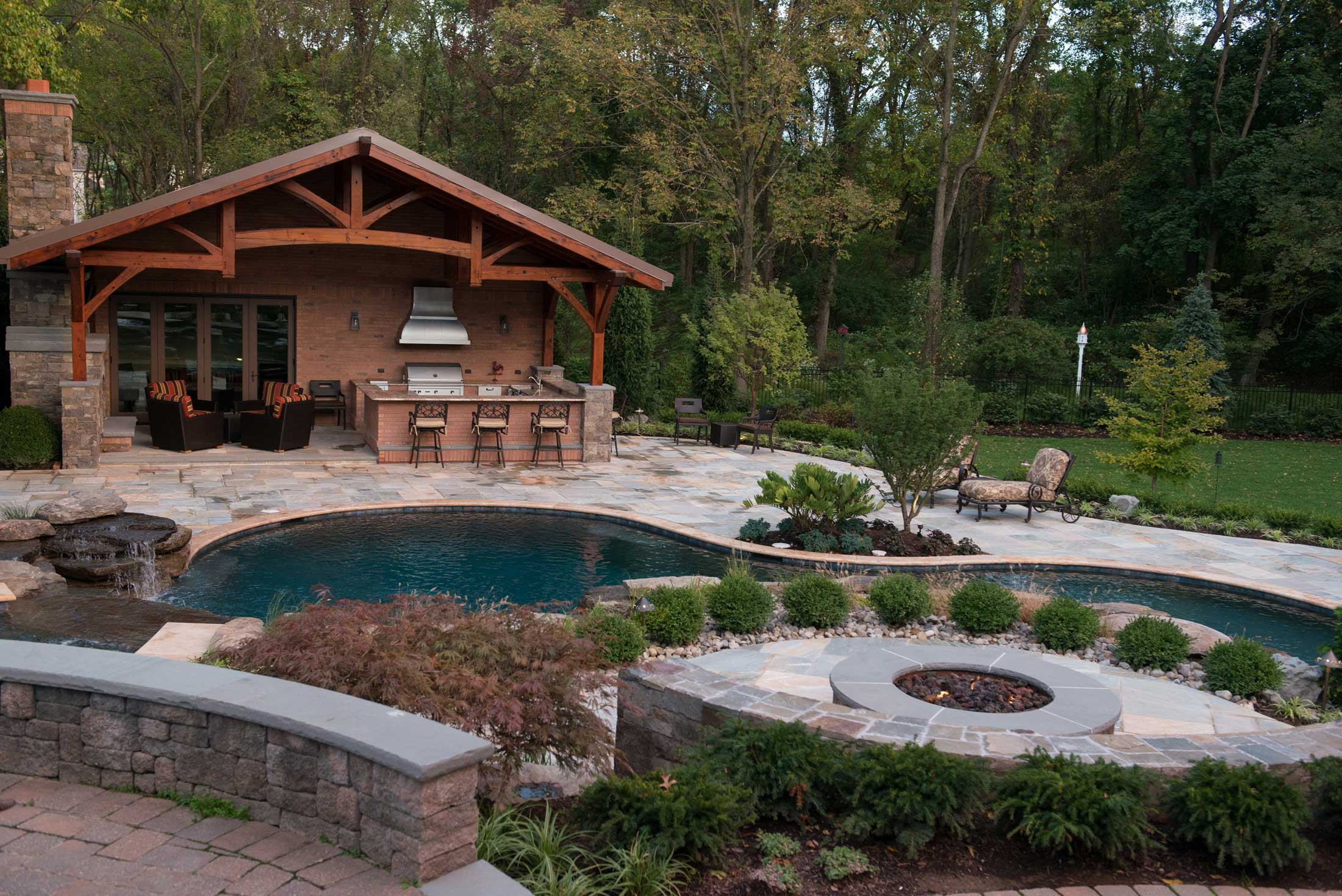 Outdoor Living with pool, bar and outdoor kitchen