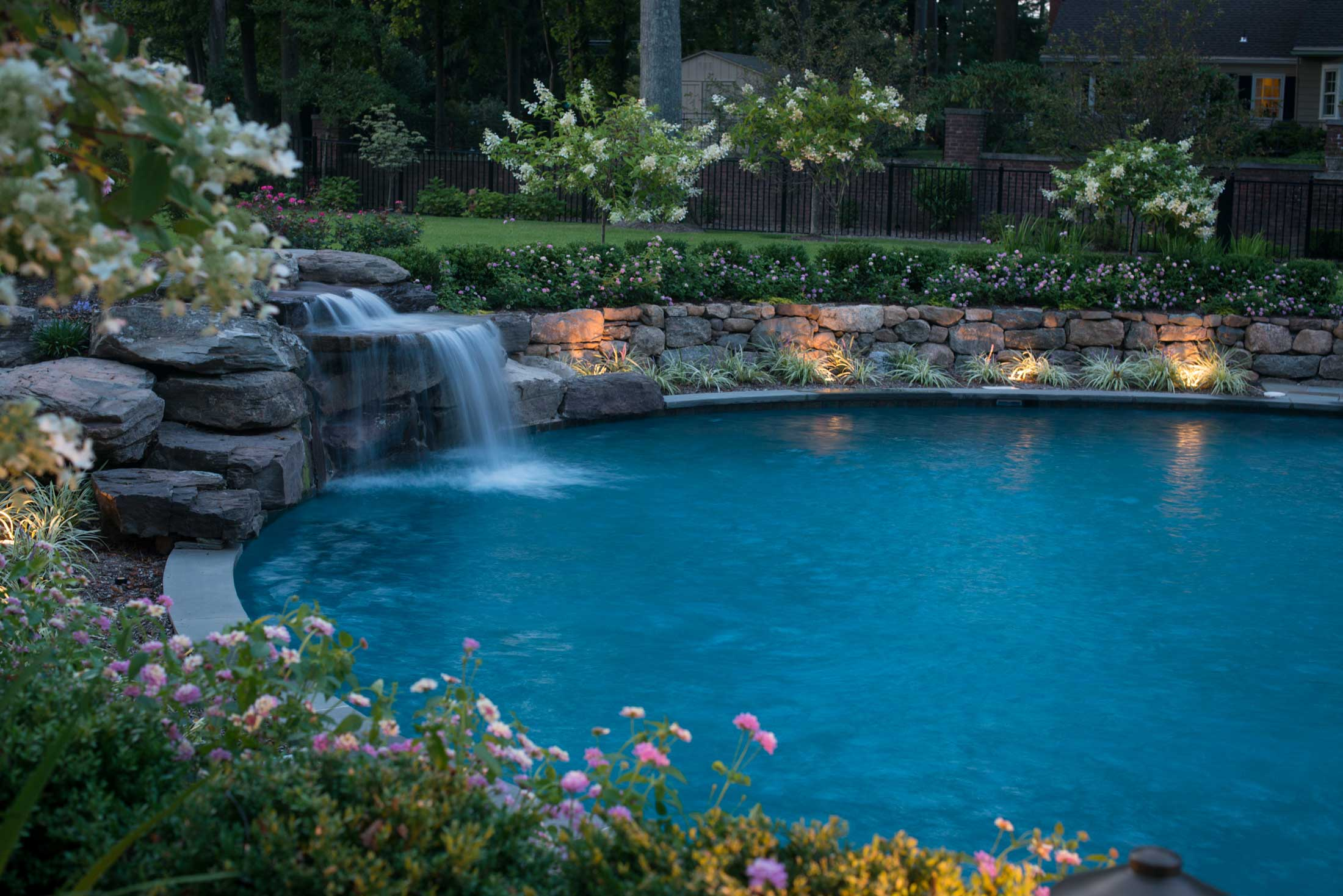 Swimming Pool Construction with custom waterfall feature