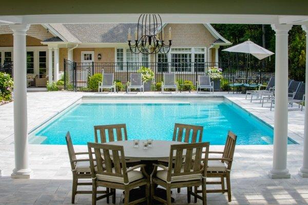 Modern swimming pool with pergola