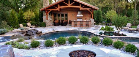 Custom pool design with pool house and firepit