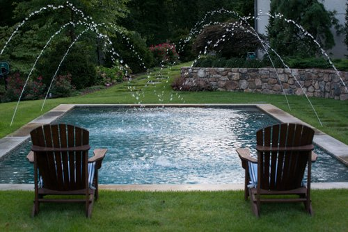 Inground pool with water feature